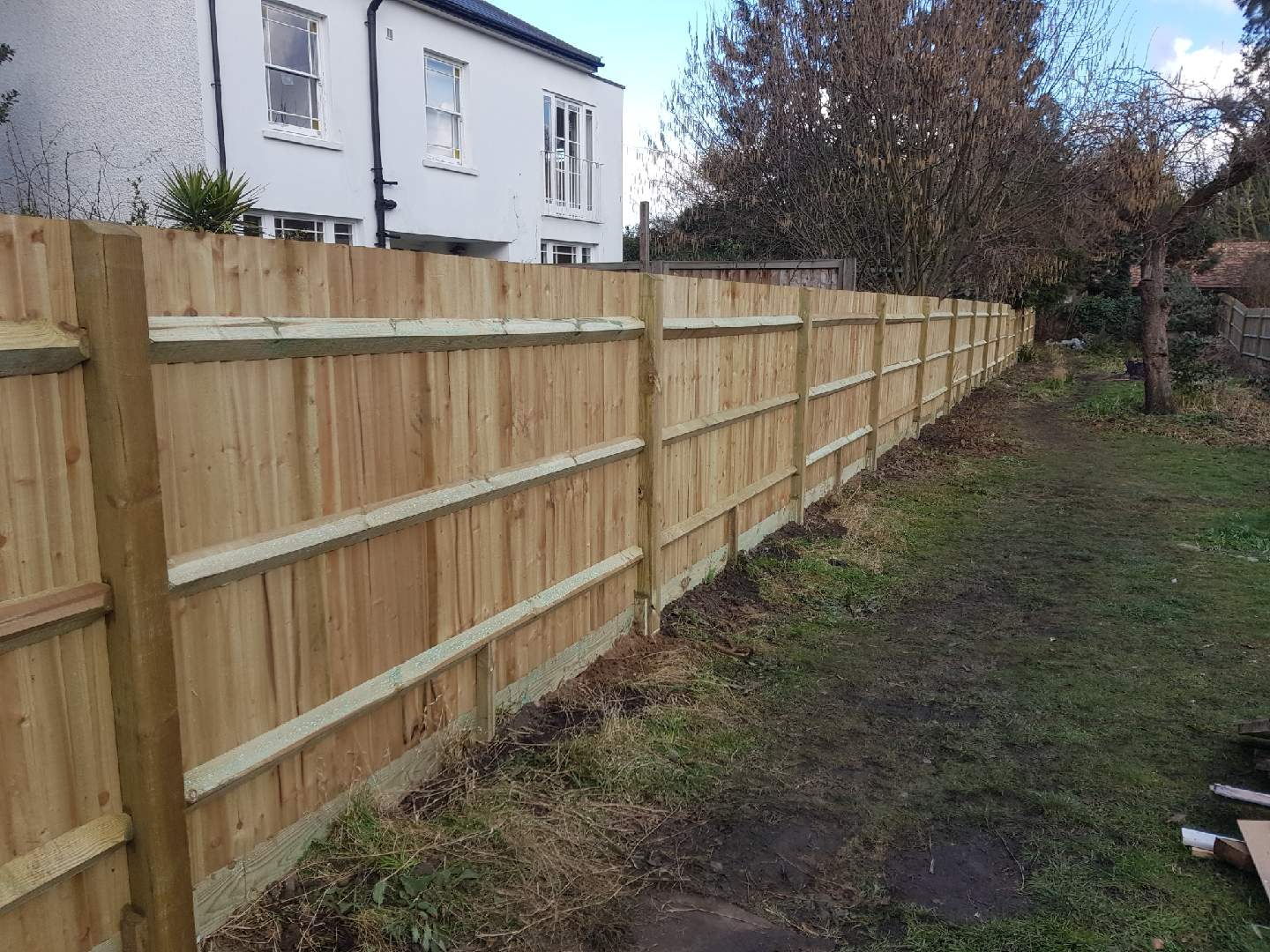 new close board fencing with wooden posts and gravel boards in Dulwich, work by South London Fencing